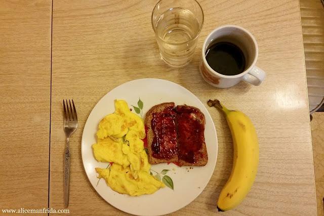scrambled eggs, toast, jam, coffee, water, breakfast, brunch