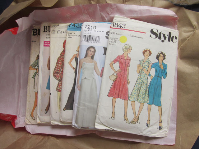 Stack of six sewing patterns