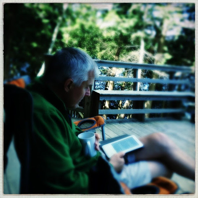 man reading on deck: simple living and eating