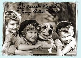 Three of the Little Rascals pose with Petey the Pitbull