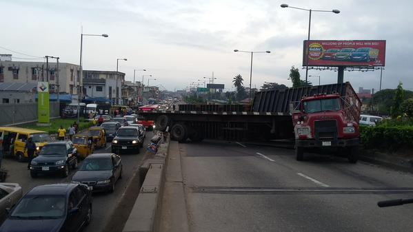Another trailer truck on Ojuelegba almost fall off the bridge.