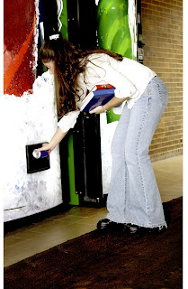 Student getting a soda from a vending machine