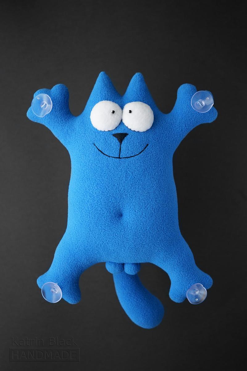 Голубой кот на присосках. Кот Саймон - игрушка.
