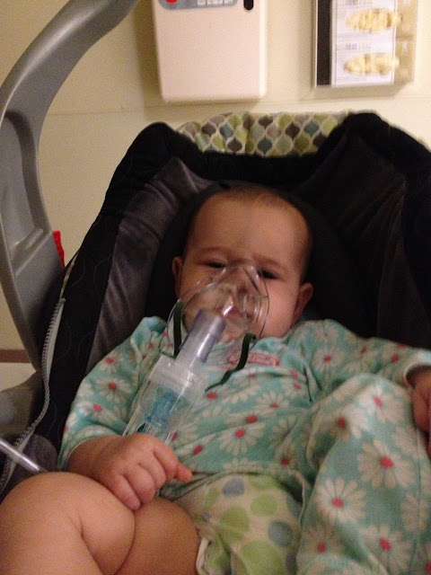 baby with a breathing mask