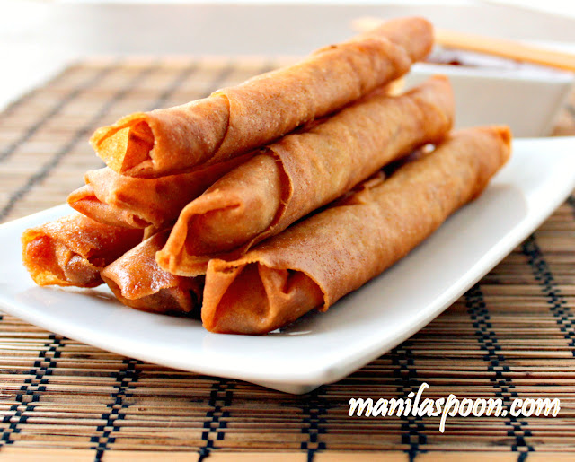 "Lumpiang Shanghai or Filipino Spring Rolls are traditionally made of ground meat (usually pork), minced onions, finely chopped carrots and seasoning all rolled up in a paper thin wrapper made with flour and water. It is sealed at the end either by using  a sticky beaten egg or plain water.   By the name it is given, you can almost guess that it has its origins in China though for some reason we haven't dropped the ""Shanghai"" at the end and continues to use it to this day. I suppose the reason for this is to differentiate this from the other kind of Lumpia which uses mostly vegetables (though occasionally with a little meat tucked in) as filling. So when you simply say Lumpia, people will tend to think you mean the plumper and bigger spring roll rather than the ""Shanghai"" which is a smaller and meatier one."