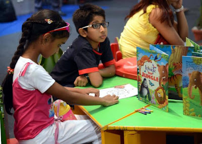 The 2013 edition of Delhi Book Fair will begin from Aug. 23 at Pragati Maidan, New Delhi. A file photo shows children browsing over the books