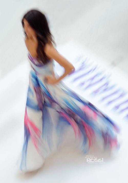 models wearing formal wear strutting along the runway in a Sydney heat of Miss Universe Australia 2012