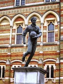 Statue of Webb Ellis carrying rugby ball