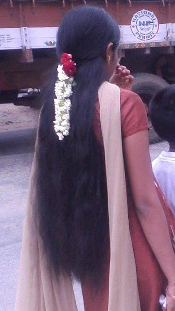 long hair tied with jasmine flowers