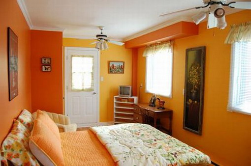 Dormitorios con paredes naranjas dormitorios colores y for Interiores pintados de gris