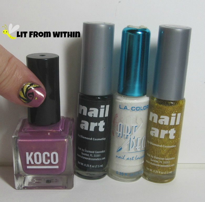 Bottle shot:  Koco Plum's The Word, and nail art stripers in black, white, and gold glitter.