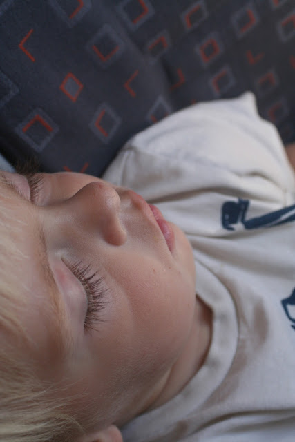 Sleeping on a plane.