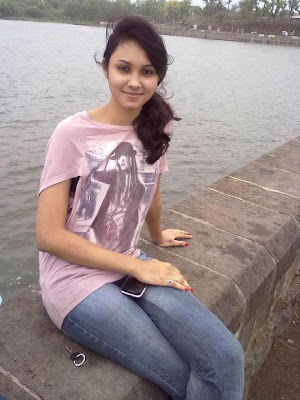 Tamil nadu software engineer girl in jeans and T-shirt.