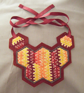 Hexagon patchwork necklace by nearlybutnotquite
