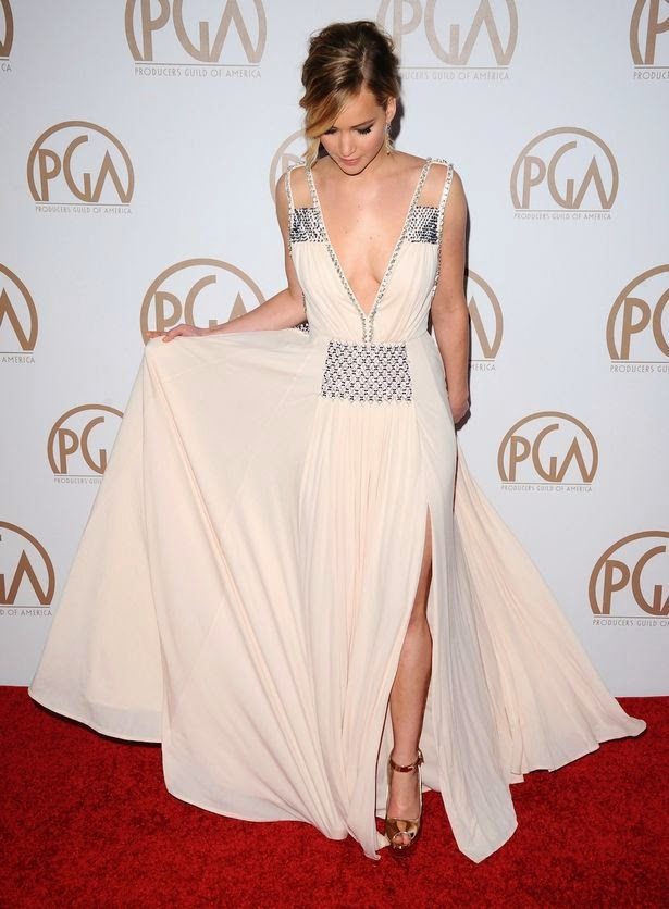 We're so happy to see that Jennifer Lawrence opted for a bright Prada gown.  The 24-year-old looked very gorgeous in a white long gown as she was radiant on the 2015 Producers Guild of America Awards in the Hyatt Regency Century Plaza.