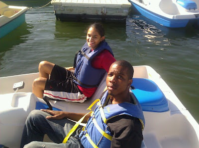 Two emcees in a pedal boat