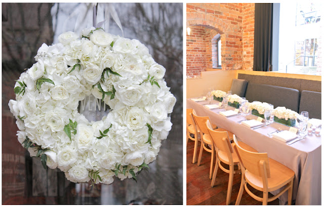 classic white fresh floral wreath for zingermans on fourth downtown ann arbor kerrytown wedding reception white ranunculus white hydrange jasmine vine wedding decor wreath guest tables long low white centerpieces sweet pea floral design michigan and detroit wedding and event florist