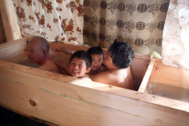 Family Bath Together 'ugyen's family sits inside
