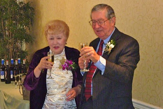 Robert and LubyAnn Hausmann toast at their 50th wedding anniversary.
