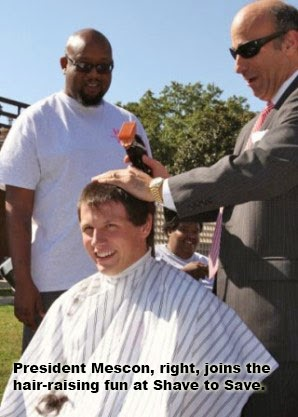 President Mescon, right, joins the hair-raising fun at Shave to Save.