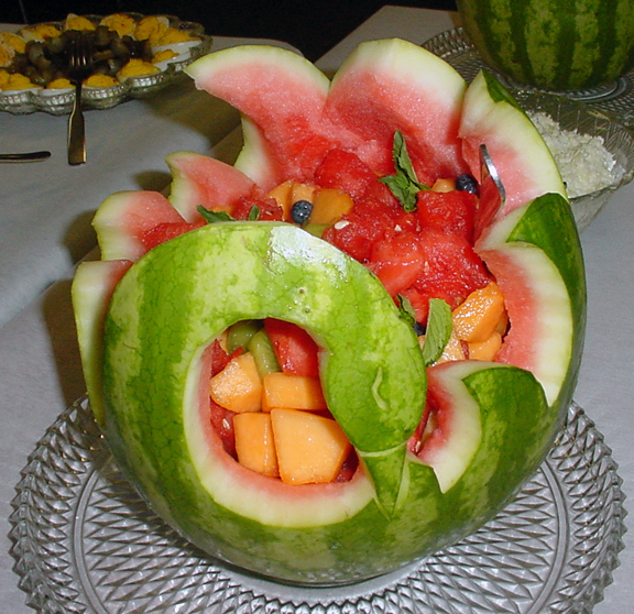 recently a friend who was catering a wedding rehearsal dinner asked me if i could carve watermelon baskets i went one better and carved her a couple of