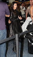 Kim Kardashian standing in line at Miami International Airport