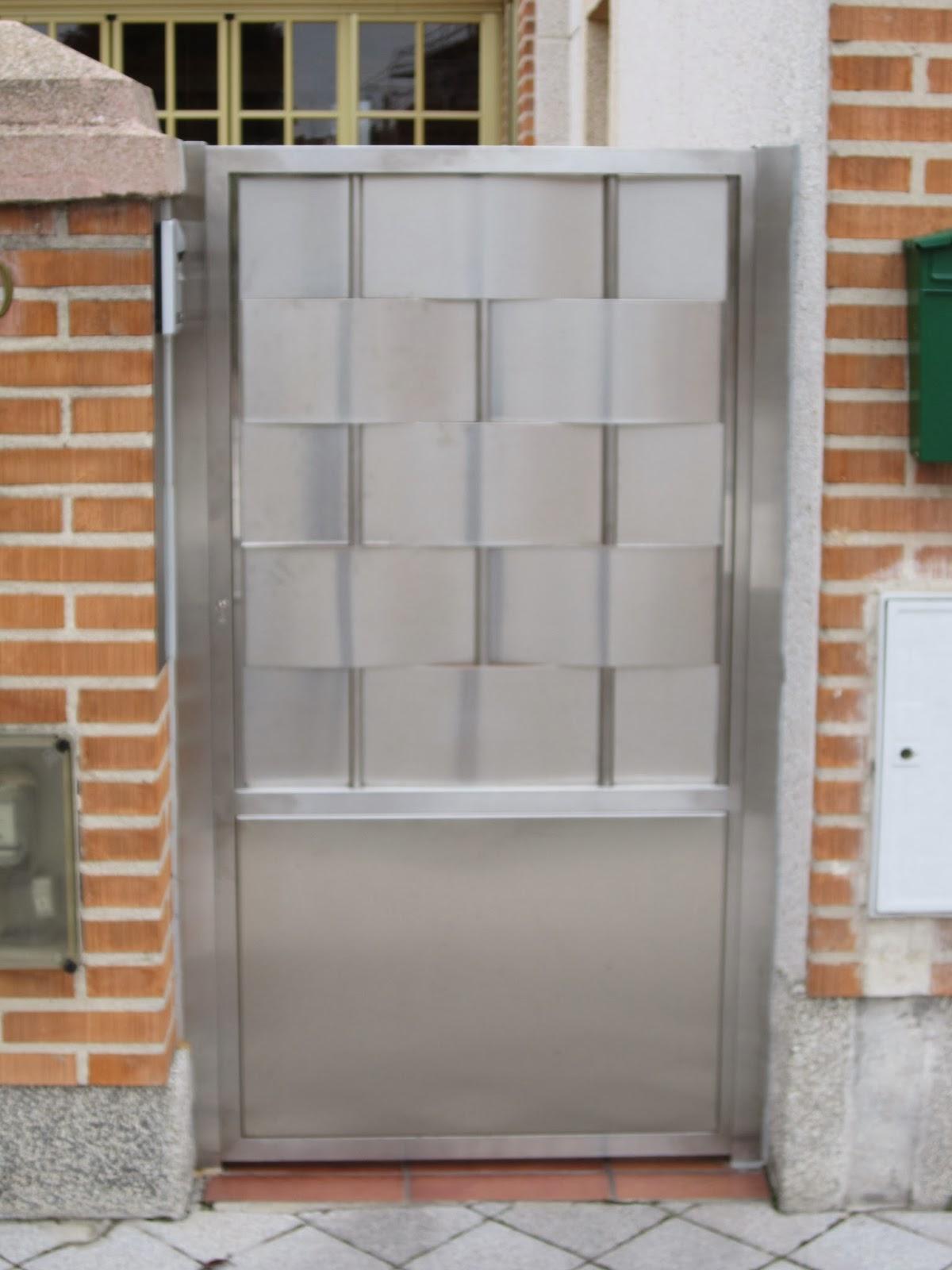 Norbel carpinteria met lica y acero inoxidable puerta y - Puerta de chapa ...