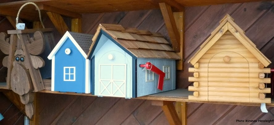 Log Cabin And Barn Shaped Mailboxes On Display At Pine Ridge Grocery