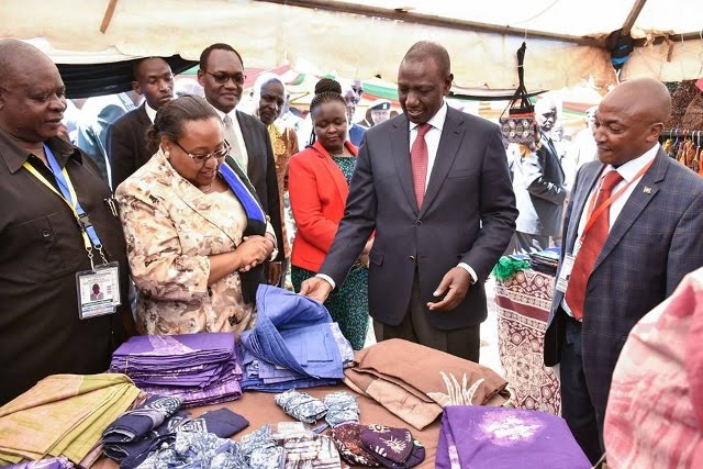 Deputy President of Kenya H.E. Hon. William Ruto admires products from SMEs