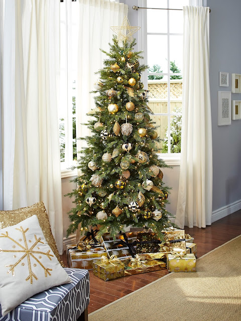 Gold ornaments on narrow Christmas tree. Gold wrapping paper | CANVAS Christmas Collection