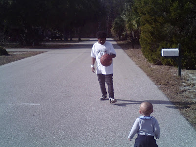 Baby walking; Big brother bouncing the basketball