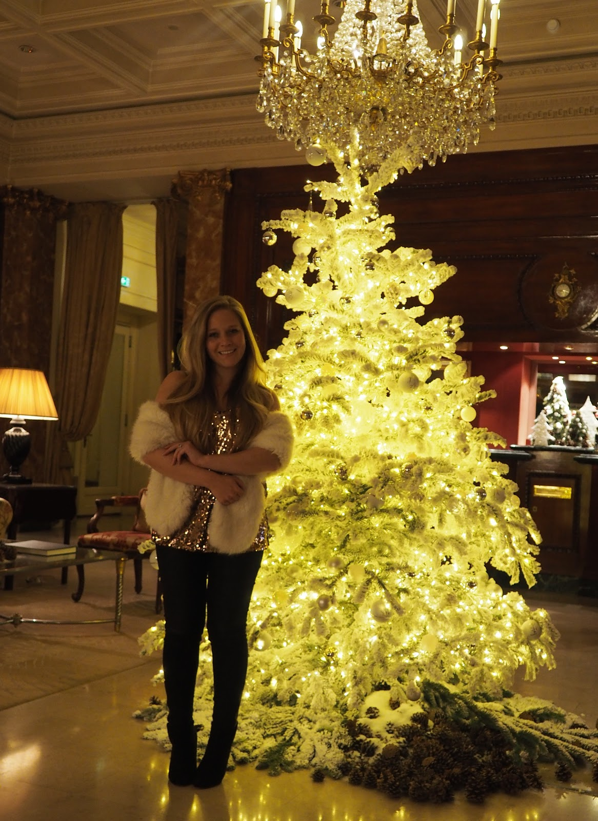 Girl standing in the lobby of The Hotel Westminster, Paris, Christmas time