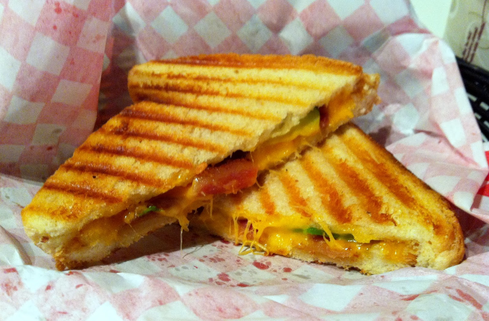 Her deluxe grilled cheese was made with cheddar, tomato and avocado ...