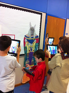 Students using tablets to take pictures of artwork