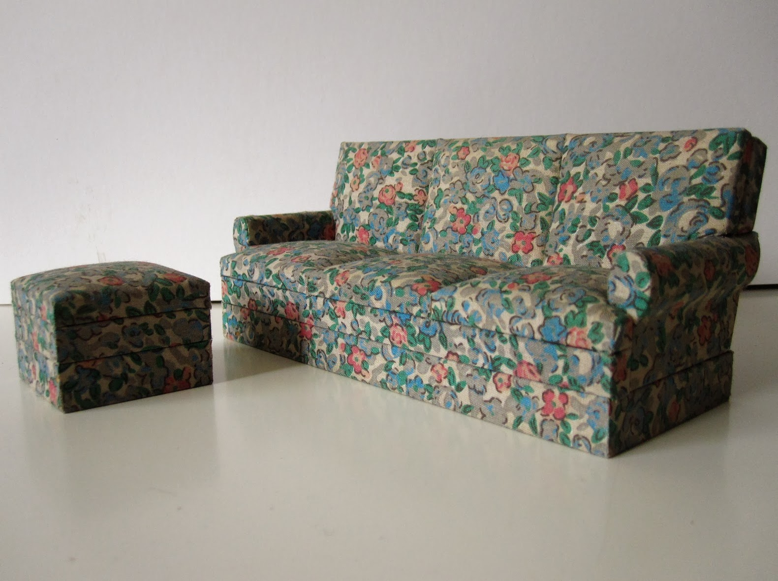 Vintage dolls house miniature three seater sofa and footstool from The Old Tythe Barn at Blackheath