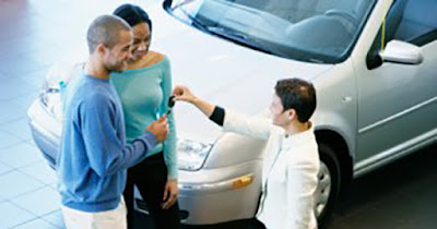 African American family receiving a car