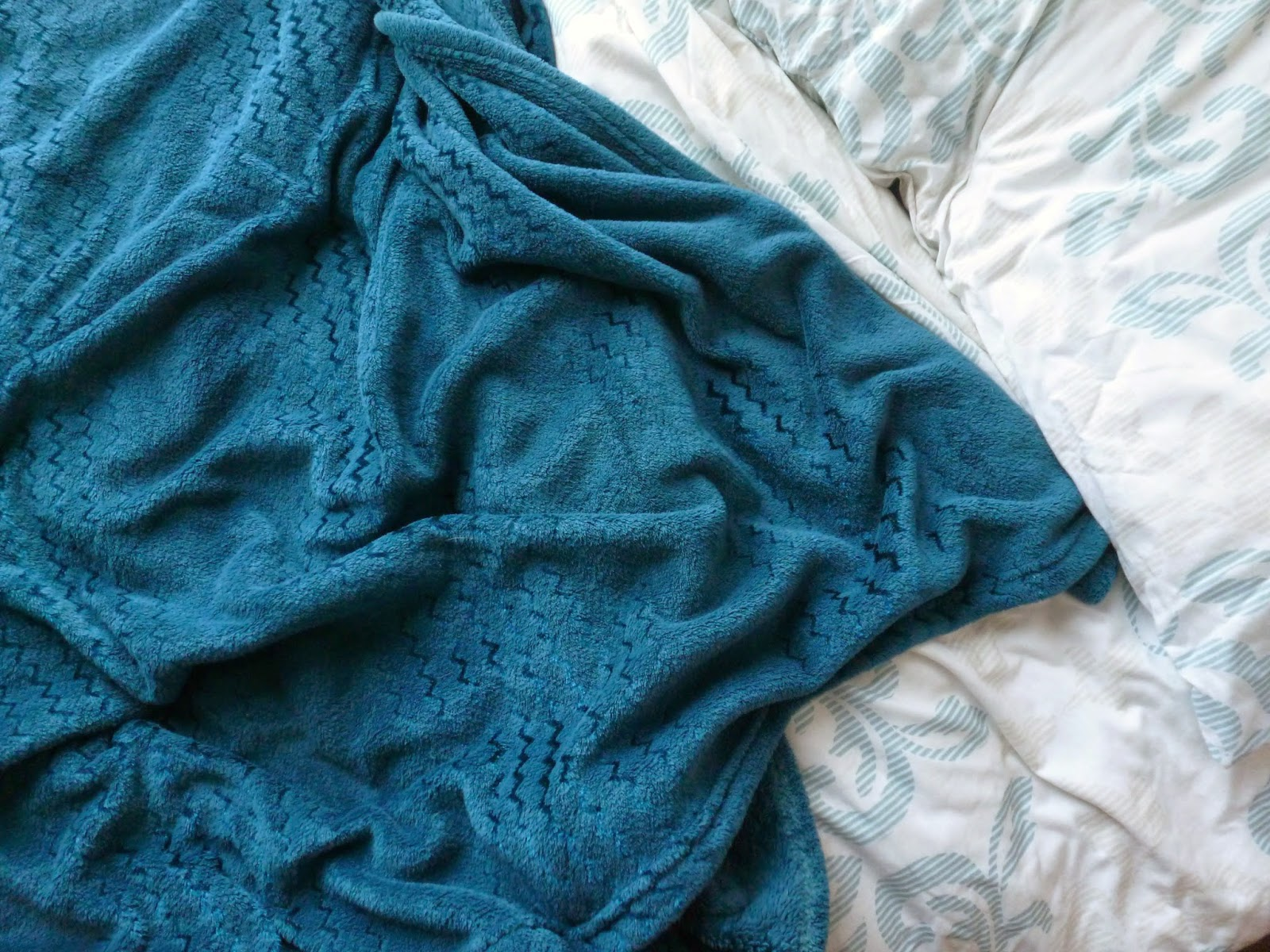Fluffy blue blanket and bed spread