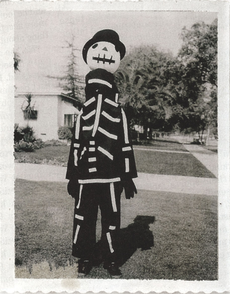 Tim Burton wearing a Halloween costume made by his mother.