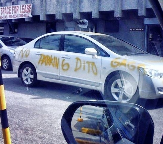 No parking sign spray painted on car in manila philippines