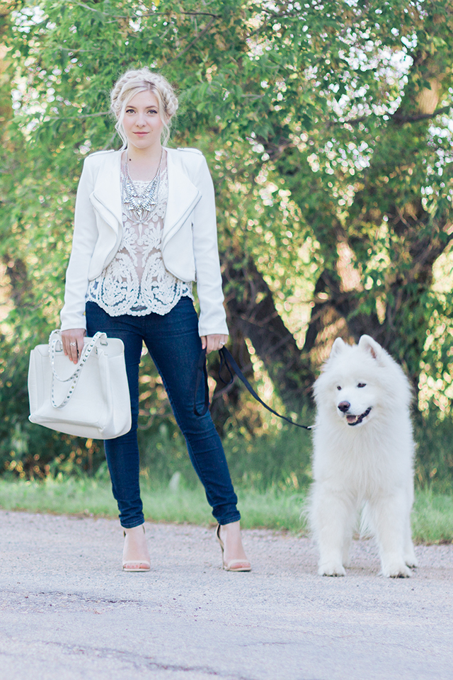 White jacket with white crochet shirt.