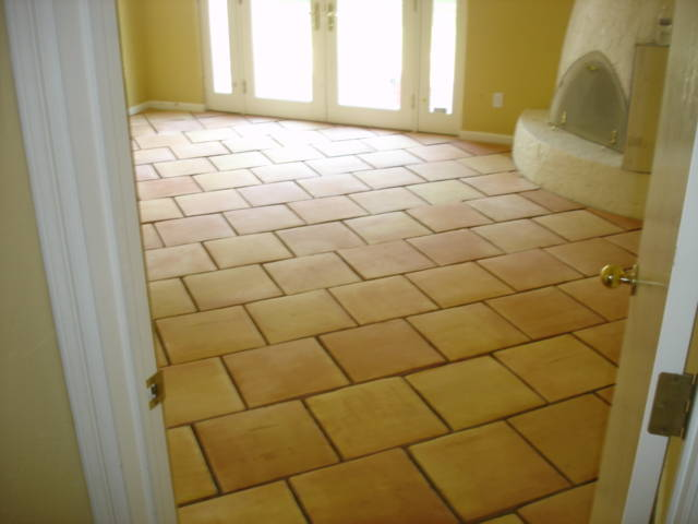 The basement ideas the endless piles of basement flooring for Best tile for basement floor