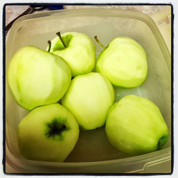 bin of peeled apples