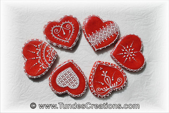 Red gingerbread hearts with lace design by Tunde Dugantsi