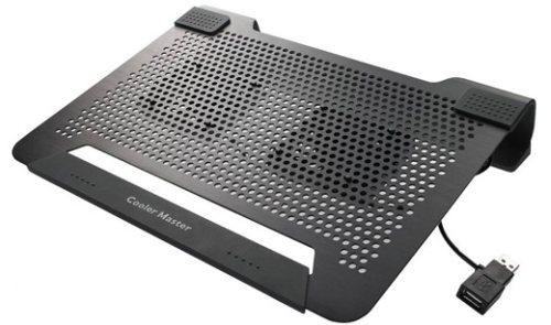 Menggunakan cooling pad agar laptop tak panas