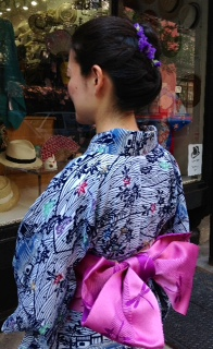 women in yukata with purple obi
