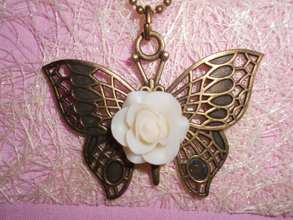 mariposa con rosa de marfil