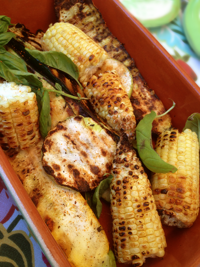 Image of grilled veggies, Italian Style with basil and dusted with paprika, salt and fresh ground pepper.