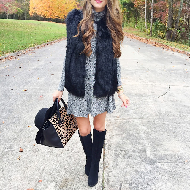 Black faux fur vest over grey dress