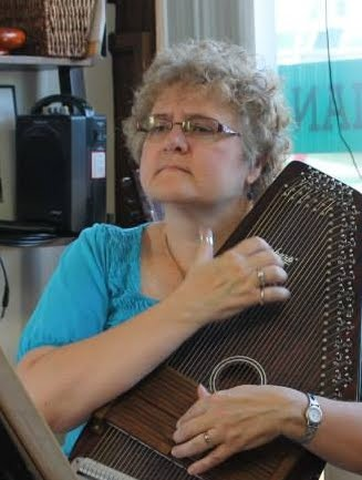 Playing the autoharp