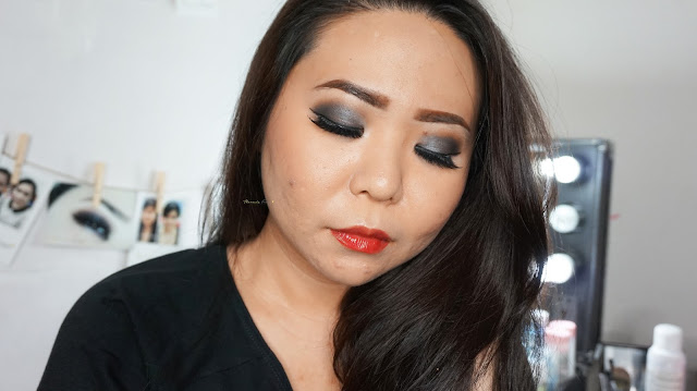 Sultry smokey look with Urban Decay Naked One palette in the color of gunmetal, creepy, buck and virgin. Combined with a red natural lip gloss from Bourjois Rouge Edition Aqua Laque in 04. A good combination for a bridal look for dinner reception. If you are looking for a make up artist in Jakarta, kindly contact me.